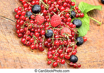 Healthy berry fruit on rustic table
