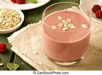 Healthy berry with raspberry, oatmeal and mint in a glass