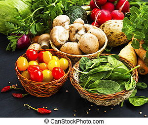 Healthy bio vegetables assortment with cherry tomatoes, mushrooms, spinach and spices