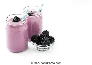 Healthy blackberry smoothie in glass isolated on white background