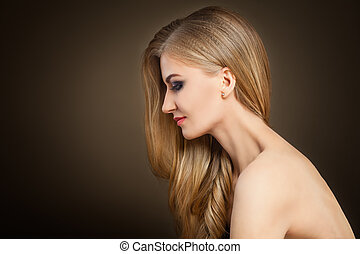Healthy Blonde Woman with Long Hair on Dark Background with Copy space
