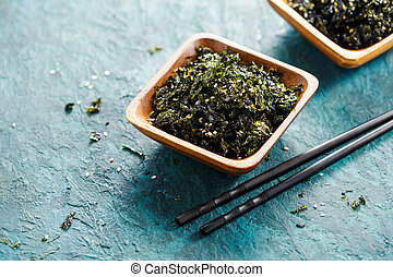 Healthy bowl of seaweed with sesame and sea salt. Food background with copy space.