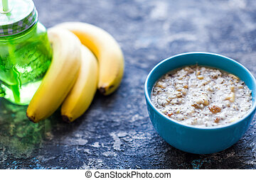 healthy breakfast bowl. oatmeal with banana, raisins, walnuts, chia seeds