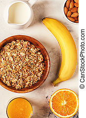 Healthy breakfast - bowl of muesli, nuts and fruit