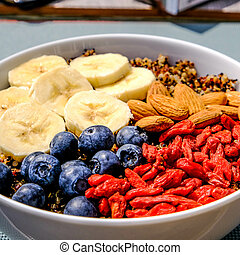 Healthy Breakfast Bowl of Quinoa With Fruit and Nuts