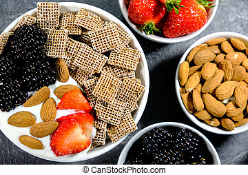 Healthy Breakfast Cereals With Fresh Fruit and Yogurt