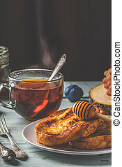 French toasts with honey, fruits and tea - Healthy breakfast...