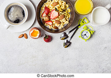 Healthy breakfast concept. Whole grain rings cheerios, coffee, orange juice and egg.