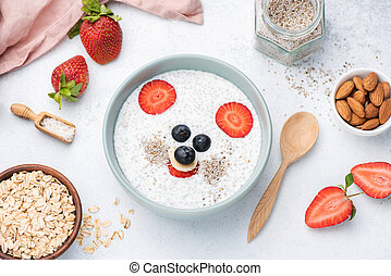 Healthy breakfast for kids with funny face food art