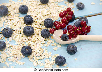 Healthy breakfast Fresh granola, muesli in bowl with milk and berries on a white background