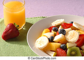 Healthy breakfast - fruit salad and juice