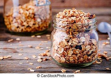 Healthy breakfast homemade granola in glass jar