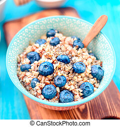 Healthy breakfast ingredients. Buckwheat blueberries mint honey on white wooden background, top view, copy space