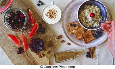 Healthy breakfast. Oat Flakes Porridge with toasts and ...