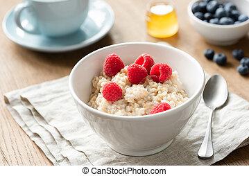 Healthy Breakfast Oatmeal Porridge Bowl With Berries Honey