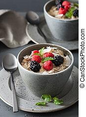 healthy breakfast oatmeal porridge with raspberry blackberry