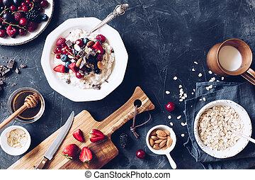 Healthy breakfast oatmeal porrige with berries