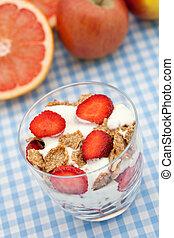 Healthy breakfast of bran flakes with strawberries