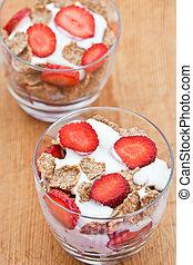 Healthy breakfast of bran flakes with yogurt and strawberries