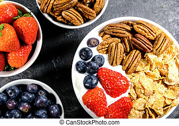 Healthy Breakfast of Cereals With Fresh Fruit and Nuts