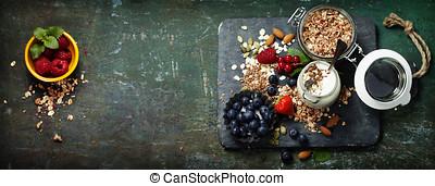 Healthy breakfast of muesli, berries with yogurt and seeds...