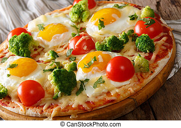 Healthy breakfast pizza with eggs, broccoli, tomatoes and parsley close-up. horizontal