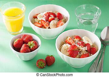 healthy breakfast quinoa with strawberry banana coconut flakes