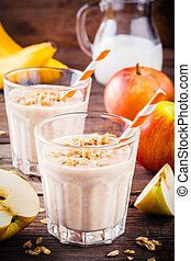 Healthy breakfast: smoothie with granola, red apple and banana