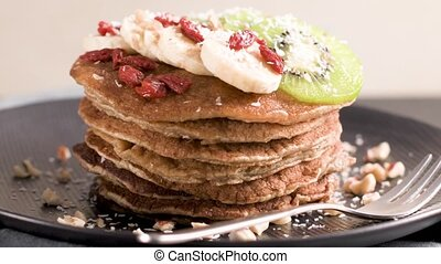 Healthy breakfast table, homemade pancakes with kiwi,...