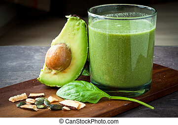 Healthy breakfast vegetable smoothie made from spinach and avocado