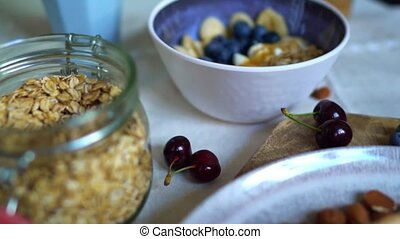 Healthy breakfast with berries, yogurt and oat flakes.