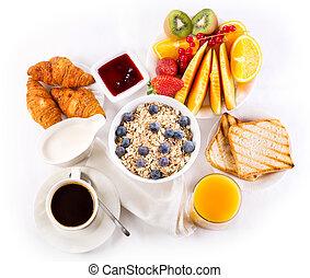 healthy breakfast with bowl of muesli, coffee, croissants, ...