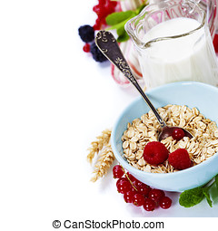 healthy breakfast with bowl of oat flakes