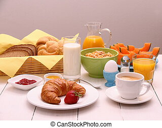 Healthy breakfast with croissants, cup of coffee and fruits