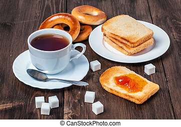 Healthy breakfast with cup of tea, bread, butter and jam