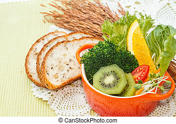 Healthy breakfast with fruits and vegetables salad