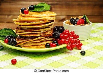 Healthy breakfast with pancakes, fresh berries and muesli on...