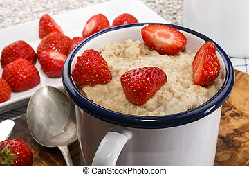 healthy breakfast with porridge and strawberry