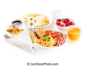 healthy breakfast with scrambled eggs, juice and fruits on ...