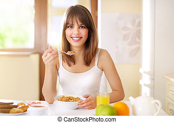 Healthy Breakfast. Woman eating breakfast