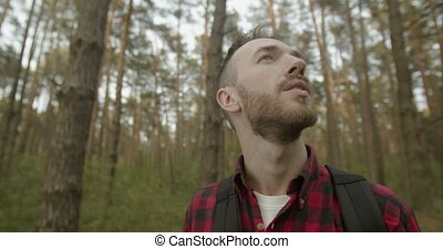 Healthy Breathing in the Forest - Young bearded man in red...