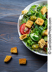 Healthy Caesar salad made of fresh vegetables with croutons