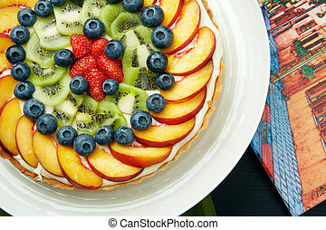 Healthy Cake with Fresh Fruits on a White Plate