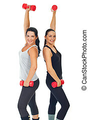 Healthy cheerful women with dumbbell