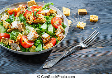 Healthy chicken salad with fresh vegetables