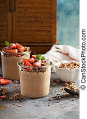 Healthy chocolate banana smoothie with granola