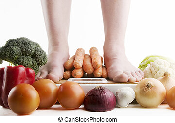 Healthy Choices - A pair of female feet standing on a...