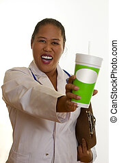 Healthy life, healthy choices. Ethnic doctor, nurse or dietician, holding a fresh juice