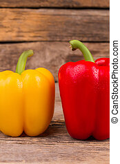 Healthy colorful bell peppers on wood.