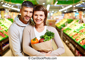 Healthy couple - Image of happy couple with paperbag full of...